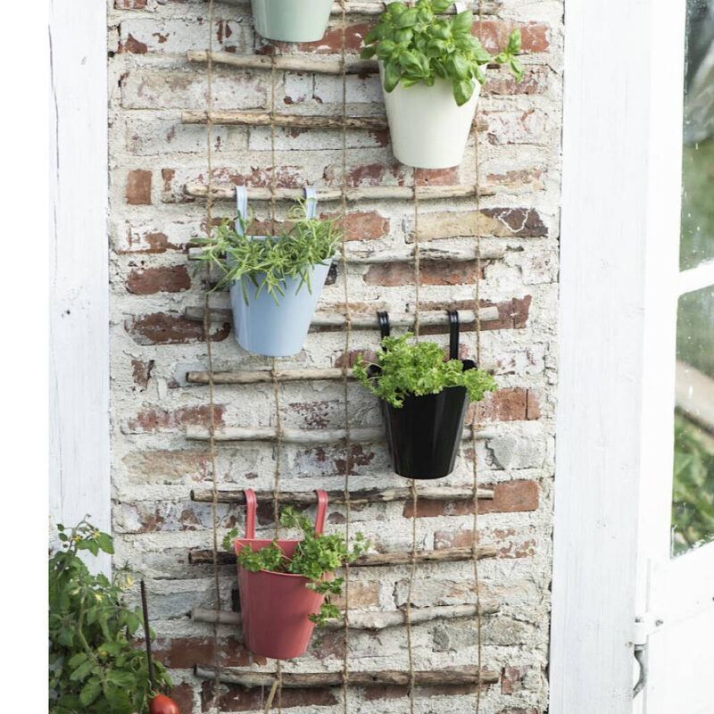 colourful hanging balcony pots for a small garden